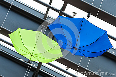 Two colored umbrellas abstract