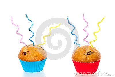 Two colorful muffins decorated