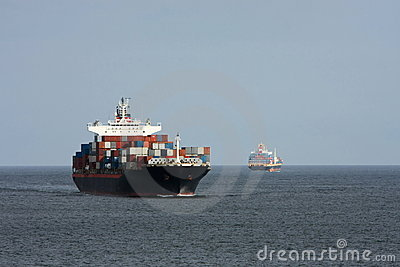 Two container ships pass at sea