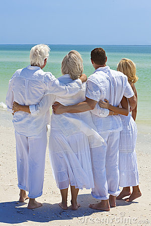 Two Couples Family Generations Embracing on Beach