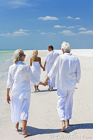 Free Two Couples Family Generations Walking On Beach Stock Photography - 16337272