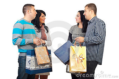 Two couples meeting  at shopping