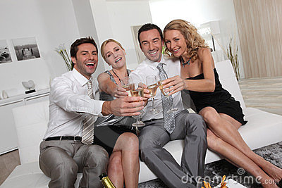 Two couples partying