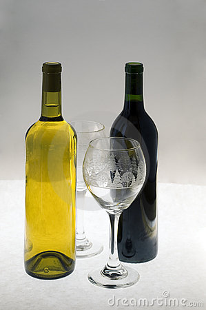 Two crystal glasses and a bottle of white wine