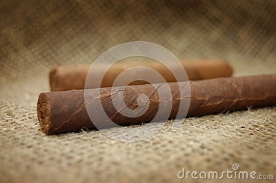 Two cuban cigars on hessian canvas