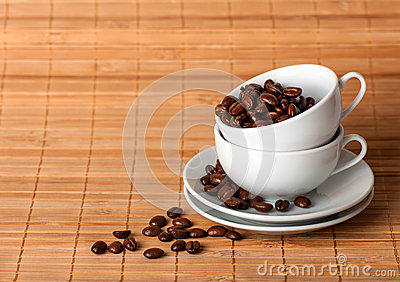 Two cups at each other with coffee grains