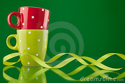 Two cups with ribbon