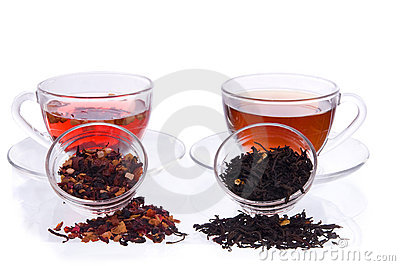 Two cups and saucers with black and fruit tea