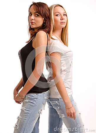 Two curvy young woman standing back