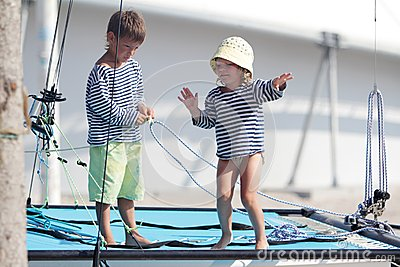 Two cute children on sea catamaran / yacht