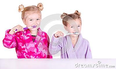 Two cute girls brushing teeth