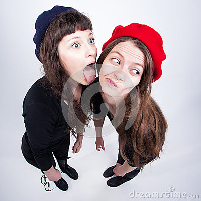 Two cute girls having fun and making funny faces