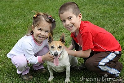 Two cute happy kids with dog