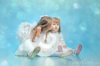 Two cute little sisters with an angel s wings