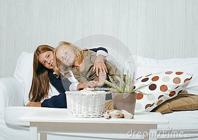 Two cute sisters at home playing