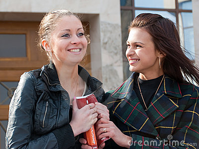 Two cute students portrait outdoors