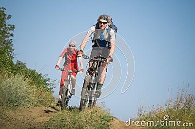 Two cyclists biking