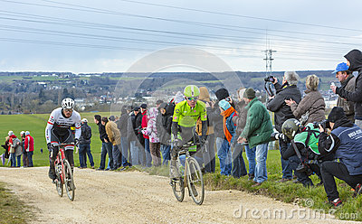 Two Cyclists on a Dirty Road - Paris-Nice 2016 Editorial Photography