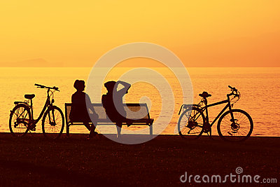 Two cyclists in silhouette