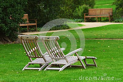 Two deckchairs in a park