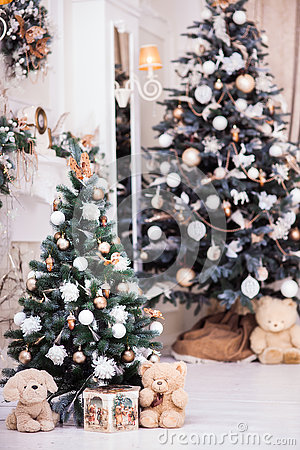 Free Two Decorated Christmas Tree With Gift Box Near Classical Firepl Royalty Free Stock Images - 80813669