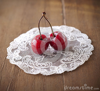 Two delicious ripe cherries