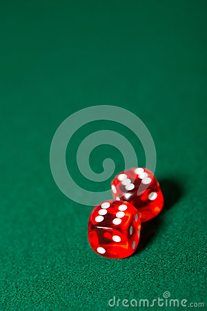 Two dices on the poker table