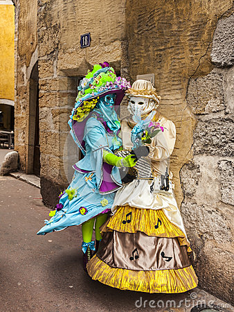 Two Disguised Persons on a Narrow Street Editorial Photo
