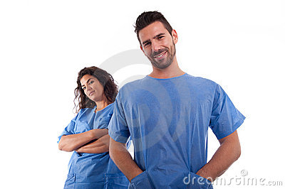 Two doctors in blue hospital uniforms