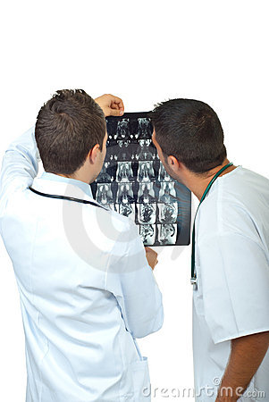 Two doctors men examine magnetic resonance