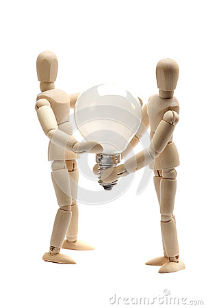Free Two Dolls Holding A Light Bulb Royalty Free Stock Image - 26876226