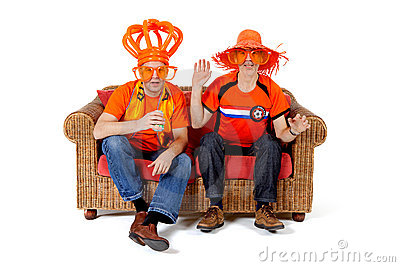 Two Dutch soccer fan watching game