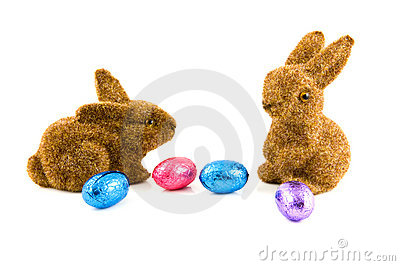 Two easter bunnies with easter eggs
