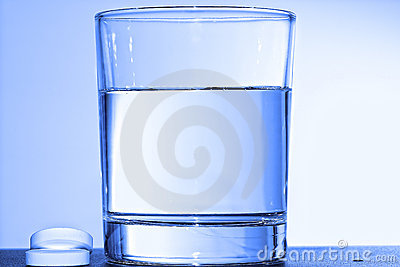 Two effervescent tablets and glass with water