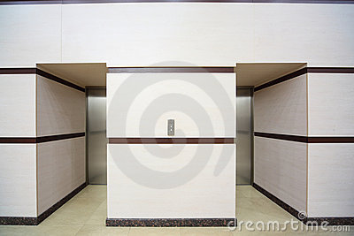 Two elevators with closed metallic doors