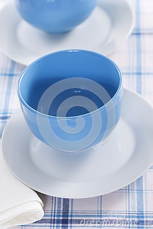 Two empty blue plates for the soup