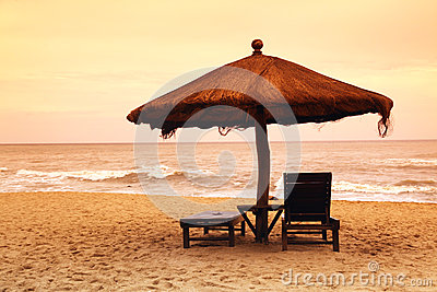 Two empty chairs on beach