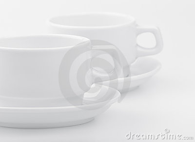 Two empty white cups