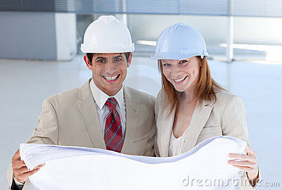 Two engineers discussing a construction project