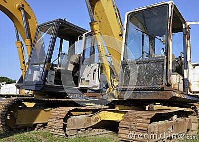 Used excavators, blue sky