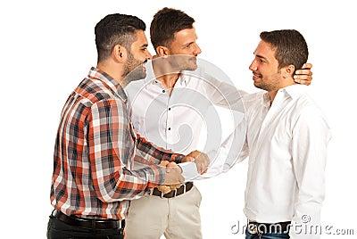 Two executives congratulate their colleague