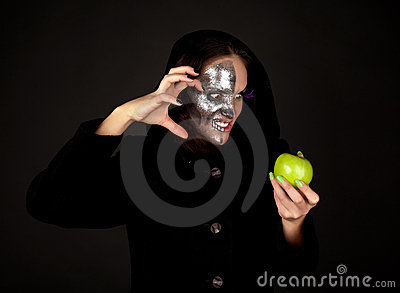 Two-faced witch with green apple grinning