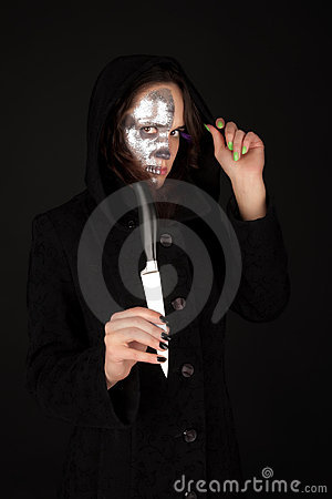 Two-faced witch holding the knife