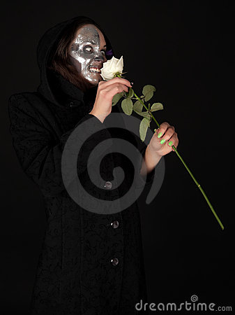 Two-faced witch holding the rose