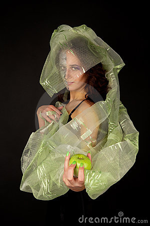 Two-faced woman with green apple