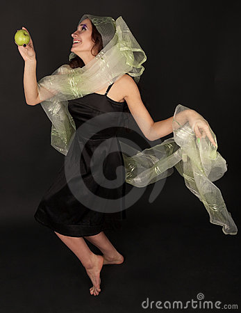 Two-faced woman with green apple dancing