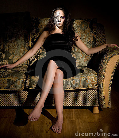 Two-faced woman sitting on the sofa