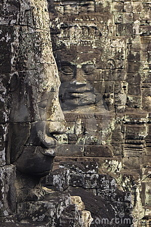 Two faces carved in the walls of Angkor Wat
