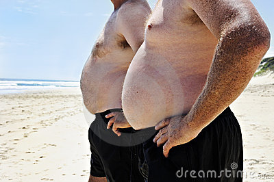 Two fat men on a beach