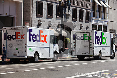 Two Fedex cars Editorial Photo